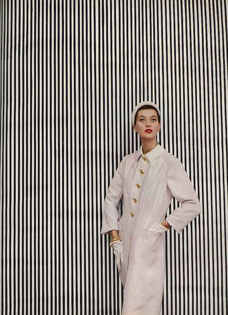 Barbara Mullen, February Vogue 1952    Barb is wearing a coat of creamy-white Italian silk by Hattie Carnegie.    photo Richard Avedon