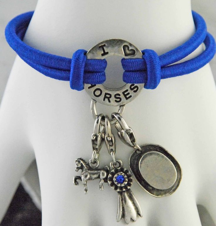 Saddleseat themed equestrian bracelet. Bungee cord bracelet with saddlebred, blue ribbon, and hat charms.
