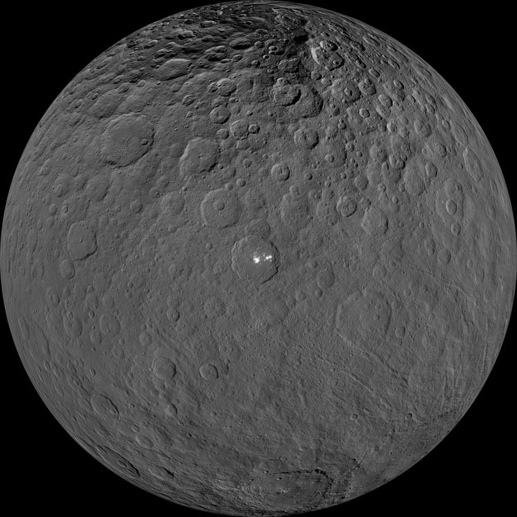 This orthographic projection shows dwarf planet Ceres as seen by NASA's Dawn spacecraft. The projection is centered on Occator Crater, home to the brightest area on Ceres. Occator is centered at 20 degrees north latitude, 239 degrees east longitude.  This image was made from views Dawn took during its low-altitude mapping orbit, at about 240 miles (385 kilometers) above the surface. The image resolution is about 120 feet (35 meters) per pixel.