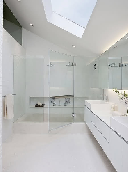 Sleek Vanity With Storage + Double Over The Counter Sinks + Over Sized Walk In Shower + Skylight