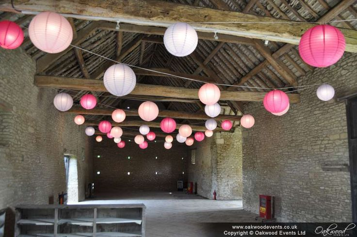 Lavender, fuchsia and pale pink for a sweetpea colour theme wedding barn party #pinkwedding #paperlanterns