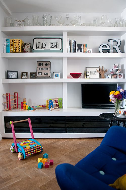 bookcase styling - eclectic mix of clock, toys, dishes, photos