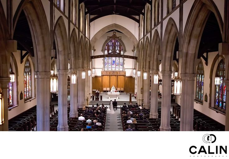 Photography by Calin - Holy Rosary Church Wedding Photography:  Holy Rosary Church is the perfect setting for your wedding ceremony and your family photos. As a Toronto wedding photographer who has seen plenty of churches and temples, I can attest to its beauty.  This image was taken during the wedding ceremony from the balcony. I learned to be at the church 15 to 20 minutes before the ceremony so I can ask the father about any rules the church might have. In this case, the Holy Rosary…