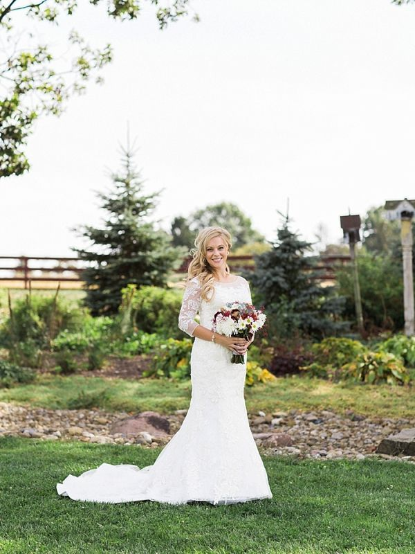 David's Bridal bride Emily in a mermaid wedding gown with lace sleeves for her elegant rustic Fall wedding.