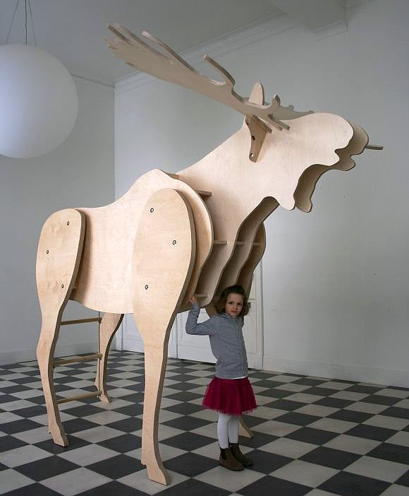 Father Moose, a 9ft tall moose with bookshelves and a place for kids to read, hide, and nap.