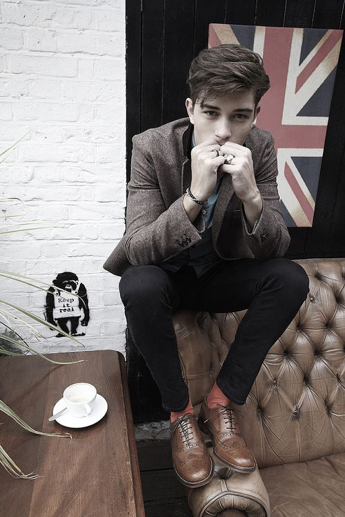 I'll like everything, from the British flag and Chesterfield sofa, to the implied cup of tea and nod to Banksy, to the model's hair, clothes and brogues.