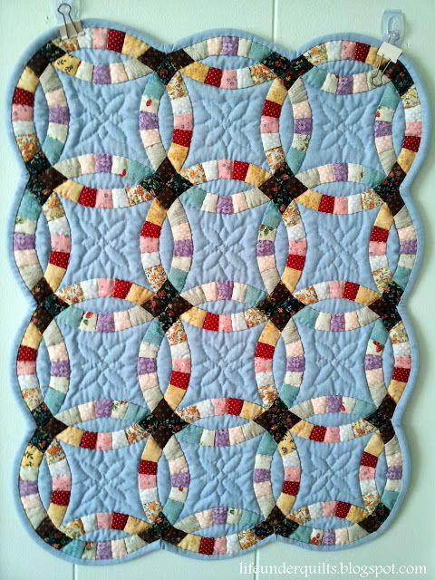 """Life Under Quilts: Double Wedding Ring hand pieced and hand quilted by Kikuyo Kubota in Hokkaido, Japan. The whole piece measures 15"""" x 19""""."""