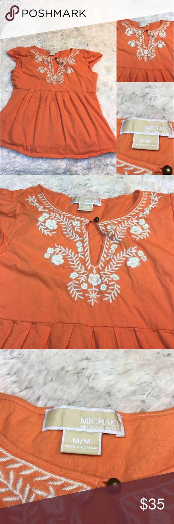 Michael Kors Orange Embroidered Top -Great condition!  -Pre loved item -I do not accept offers in the comments so please make all reasonable offers using the offer button only. :) -NO TRADES OR HOLDS 🚫 -I ship every Monday, Wednesday and Friday   💕Instagram- allisonsbeautyboutique 💕 Your purchase is going to help me graduate community college with as little debt as possible. Thank you! Michael Kors Tops Blouses