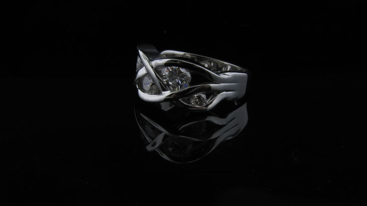 Another stunning piece made from sentimental diamonds that just aren't worn anymore.