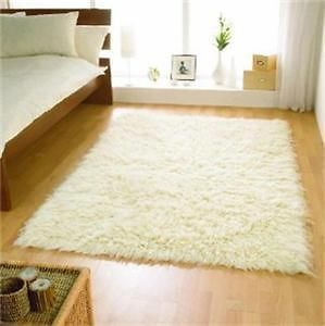 XLARGE HIGH PILE IVORY CREAM FLOKATI WOOL RUG 200X300CM There are various other sizes available through this seller as well.