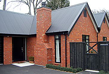 Love red brick and black windows pretty home exterior for Metal roof pictures brick house