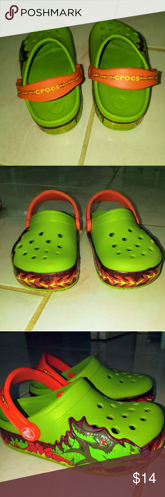 CROCS Toddler boy size C9 dragon light-ups CROCS Toddler boy size C9.  Your child will love the fire-breathing dragon on the sides and the red light-headed feature!very good condition, barely worn!  Super cool, fun, and comfy! CROCS Shoes Sandals & Flip Flops