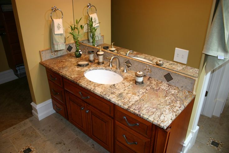 mid century bathroom design ideas with round trough sink and huge frameless mirror aside and brown bathroom countertops