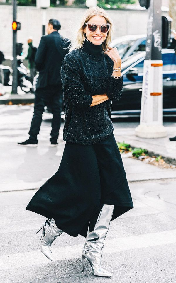 Add metallic boots and a flowy skirt to a chunky knit sweater