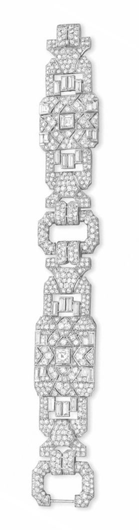 AN ART DECO DIAMOND BRACELET, BY TIFFANY & CO.   Designed as two circular-cut and single-cut diamond openwork panels, set with square-cut and baguette-cut diamond detail, spaced by two single-cut diamond open links, mounted in platinum, circa 1935, 7 1/8 ins., with French assay marks  Signed Tiffany & Co., Londres, no. 17193