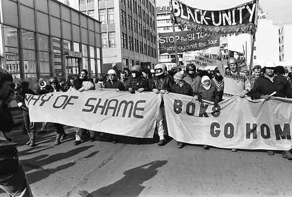 """""""Boks Go Home"""" Signs and flags were shown around the streets, trying to shame the Bok's for Practicing apartheid."""