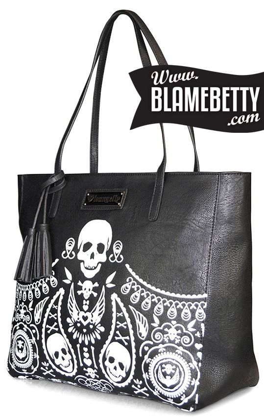 "Tote your essentials in the rad Skull Bandana Embossed Tote! This rockabilly-inspired bag will fit anything and everything you need, including a 13"" laptop. #blamebetty #skull #rockabilly"
