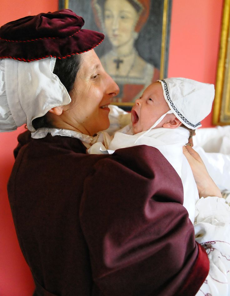 "Kentwell Advent Calendar - 8th December   Tamsin Lewis, Tudor musician: ""Yawning or singing? As a doting mother, here's my favourite picture of Rowan's first Tudor re-creation at Kentwell - aged 4 weeks."""