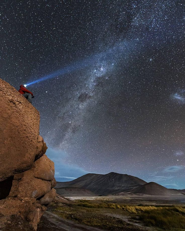"""Location: @victorlimaphoto counting stars at Piedras Rojas - Atacama Desert, Chile. Located about 150km from San Pedro de Atacama, Piedras Rojas is one of the best full day tours you can do in the Atacama Desert. The contrast of colors ranging from red rocks to green lagoons to blue skies creates a dynamic picturesque landscape. Like most places in the Atacama Desert, the night sky is unbelievable! #southamerica"""""""