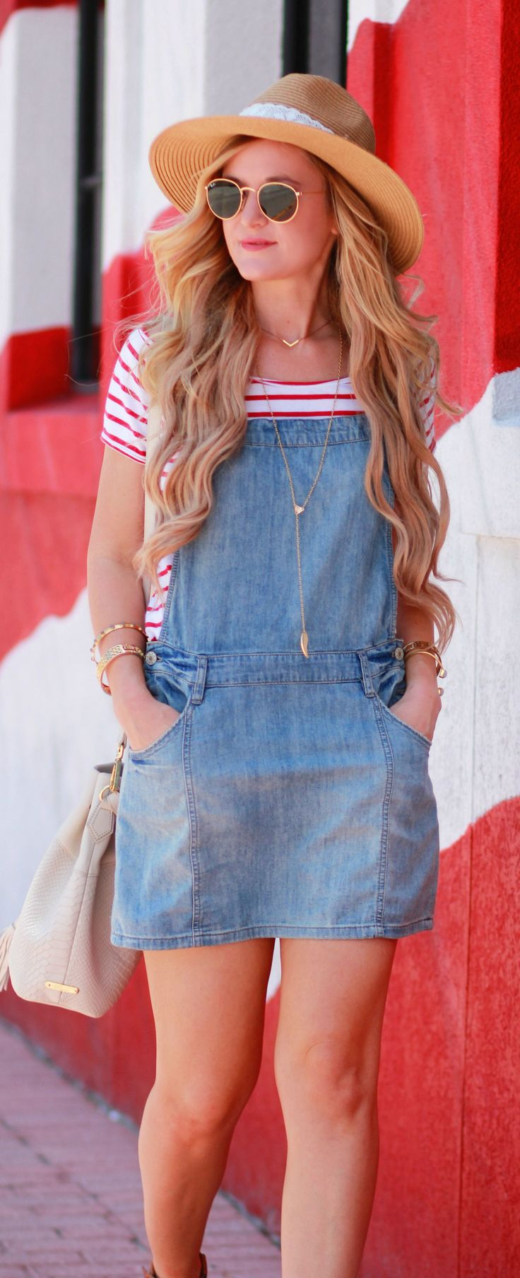 Denim skirt overalls styled with a striped tee and flatform espadrilles for a casual summer outfit