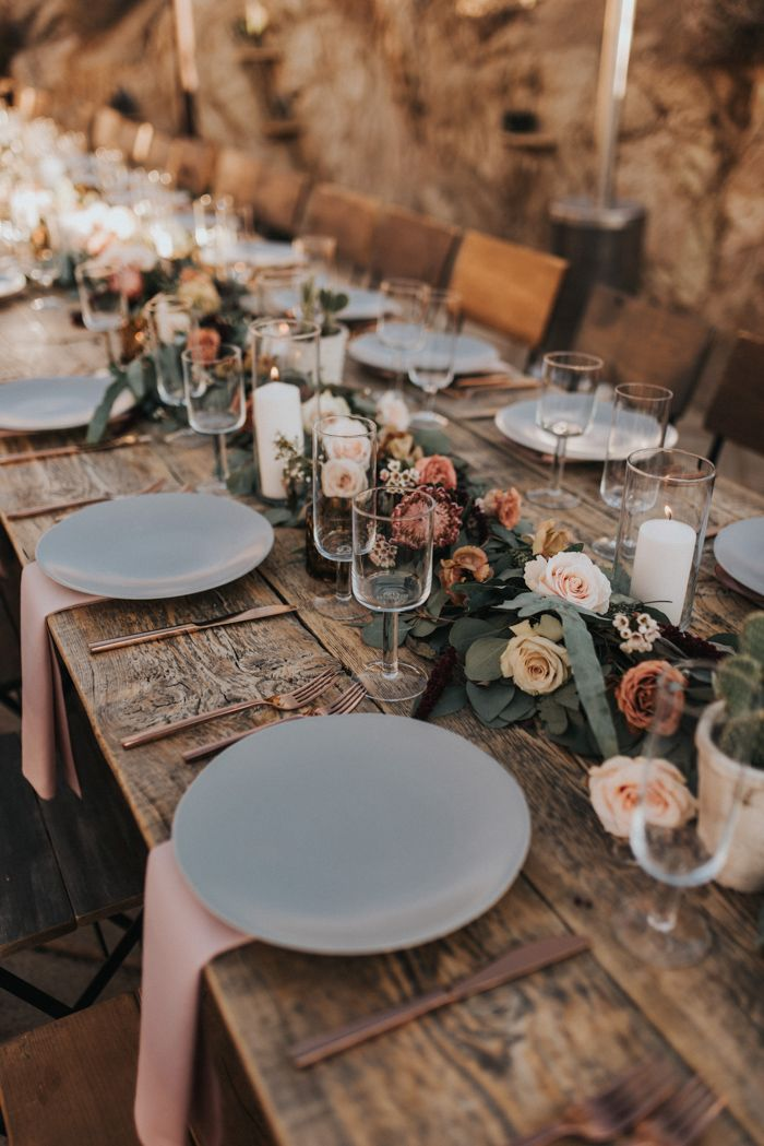 Dreamy desert-inspired reception table with pink accents, romantic florals, and rose gold touches Image by Jonnie + Garrett