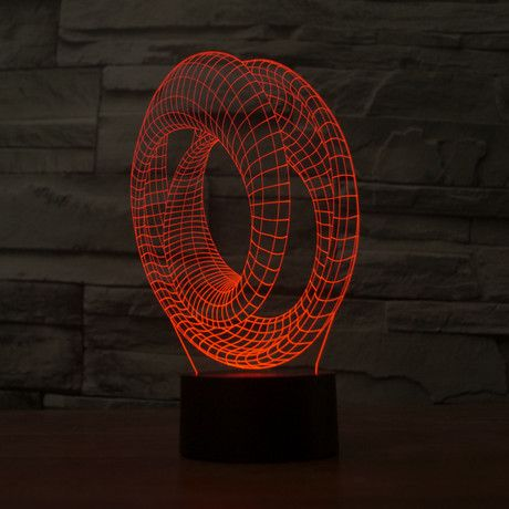 The 3D Illusion Lamp generates some of the most spectacular 3-D images that you have ever seen. Part sculpture, part warm LED lighting, and totally mind-boggling, this Cyclone will change your world. These geometrical dioramas are outlined in colo...