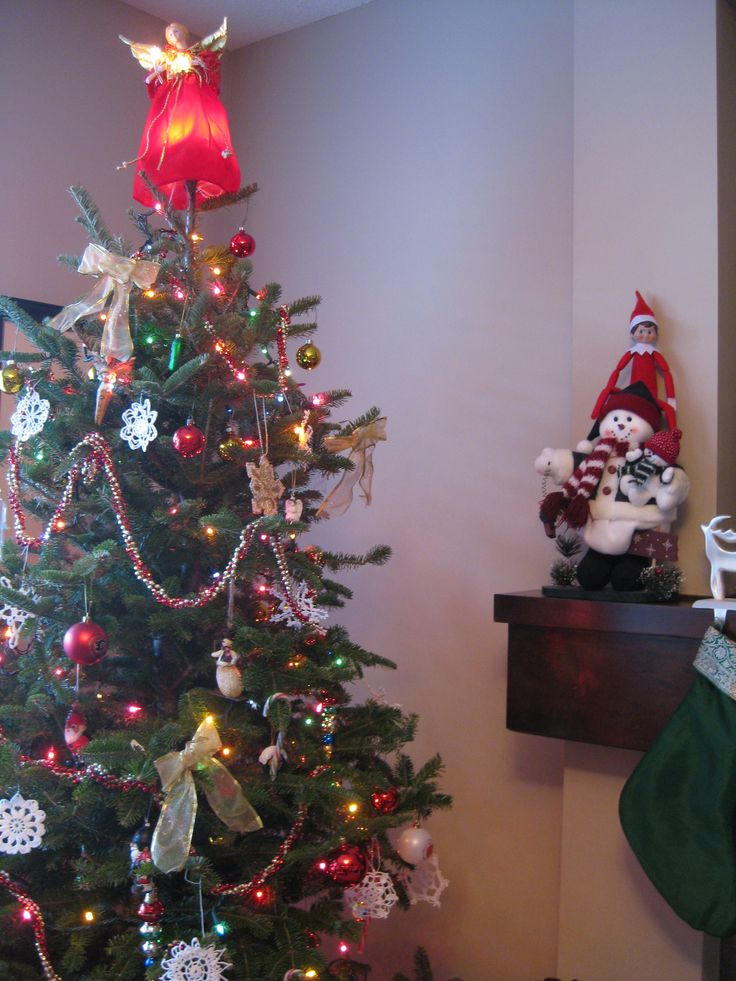 December 14, 2014 ~ Sparky chilling with our snowman on our fireplace mantel.