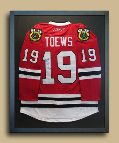 a hockey jersey framing option where the sleeves arent so pressed hockey