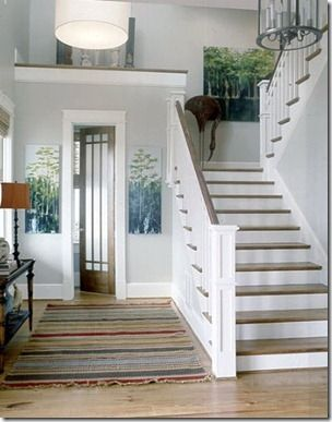 "Cool tone white and grey hallway with ""weathered colors"" striped rug"