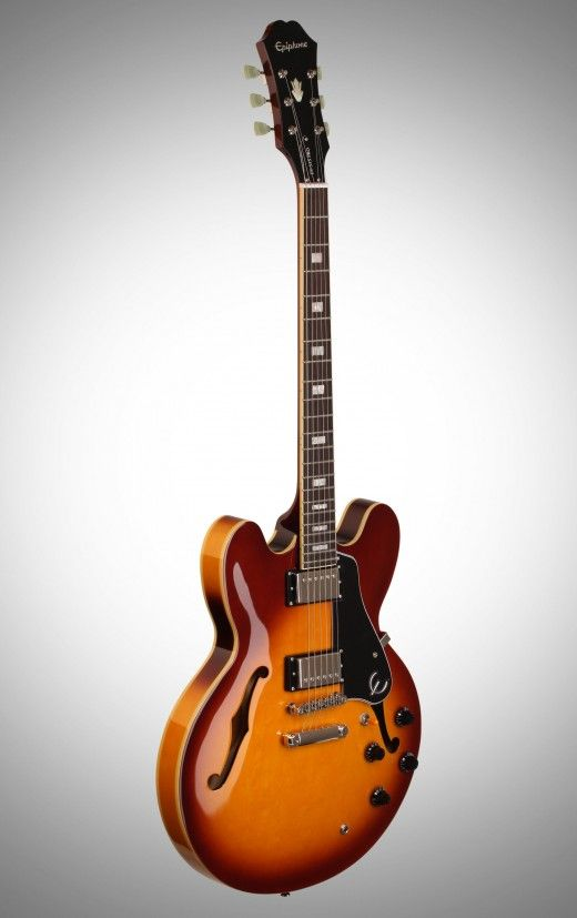 Budget Gibson ES-335? So what do we have here? a guitar with the exact same construction as the real deal (a 2015 Gibson Memphis ES 335). Or in other words, a laminated hollow body, with solid cent…(Source: adamharkusblog.wordpress.com)