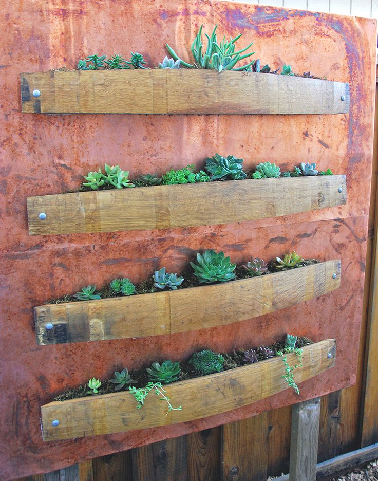 Vertical succulent planter with wine barrel staves and copper.