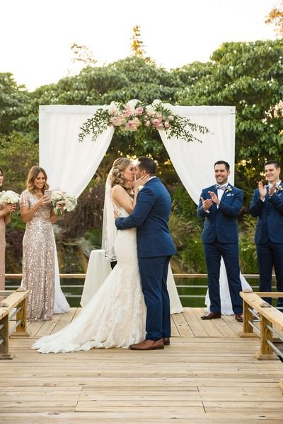 Elegant wedding ceremony decor - wedding arch with white fabric and greenery + pink flowers - outdoor wedding ceremony decor {Dana Lynn Photo, Video & Photobooths}