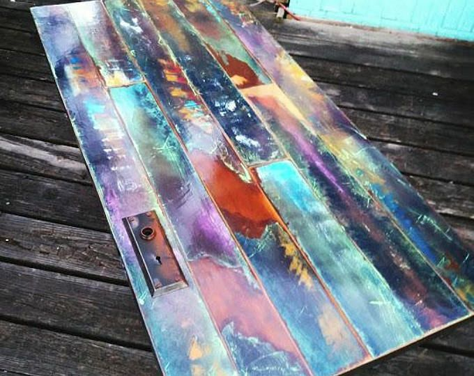 colorfully painted faux bronze weathered patina reclaimed wood coffee table, vintage door pipe leg frame. industrial, art lover gift