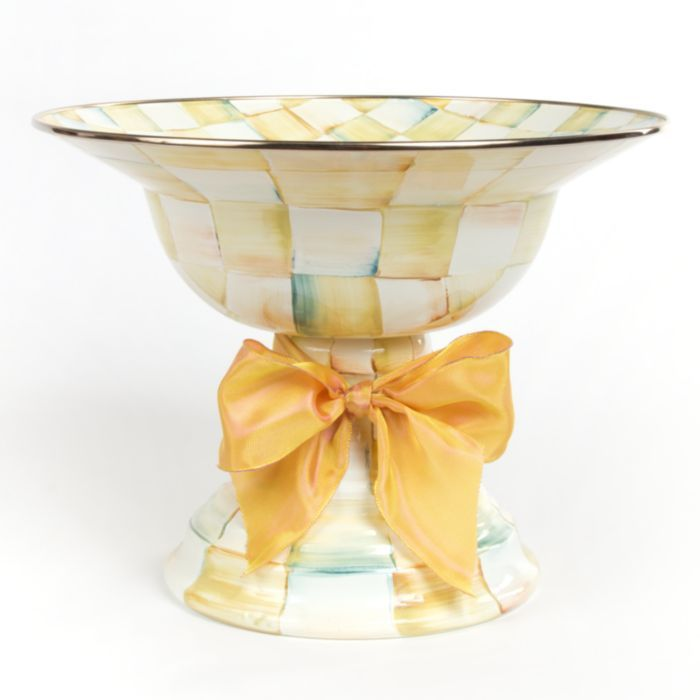 Fill this large Parchment Check™ Enamel Compote with your favorite fruits, and the result is a still-life worthy of an old master. An indispensable party serving dish, dressed up with a big ribbon bow. Hand-painted checks reveal soft accent colors. Steel underbody and bronzed stainless steel rim.