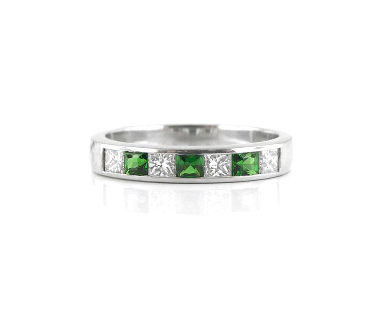 An 18ct White Gold, Diamond and Tsavorite Eternity Ring