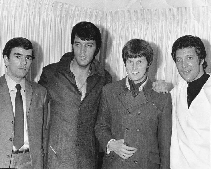 Chatting with Tom Jones at the Flamingo Hotel in Las Vegas on June 10, 1969 -  Chris Ellis (Tom's personal assistant) and Chris Slade (Tom's drummer).