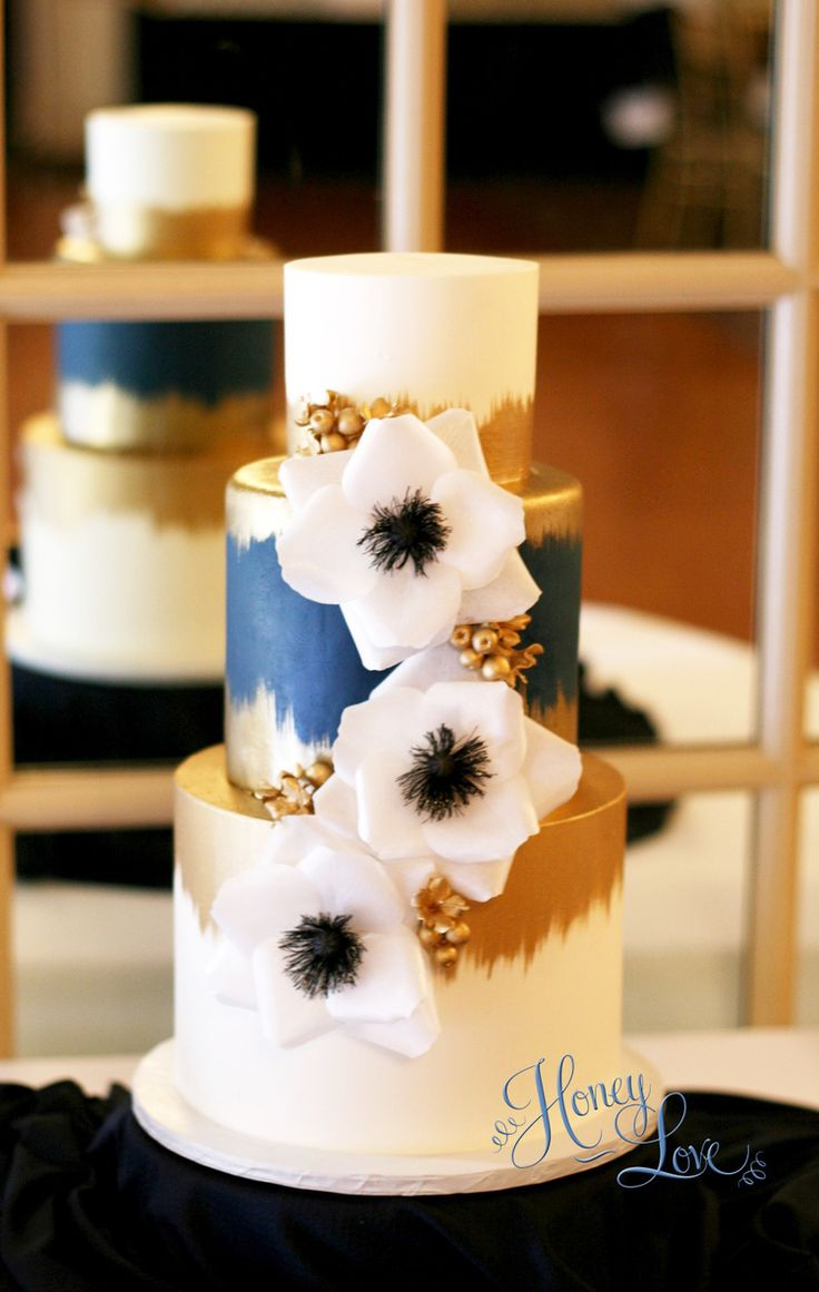 Modern white and navy wedding cake with gold accents and hand-made wafer paper flowers  — HoneyLove Cakery