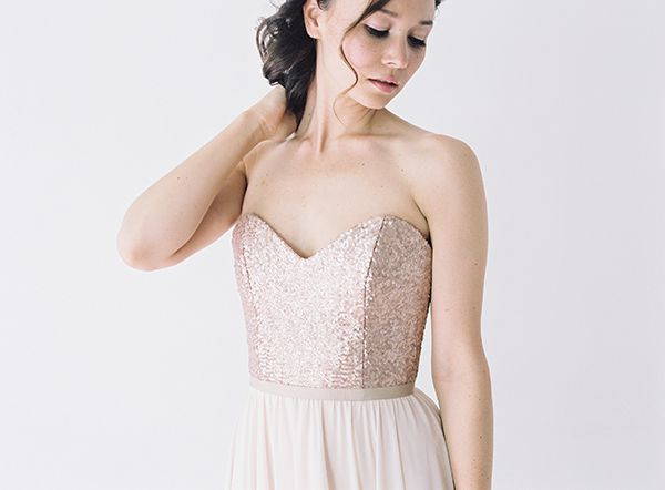 STYLE: DRS033 This gown features a sweetheart neckline and low back. The skirt is made on the bias using almond chiffon which flows effortlessly from the waist to the floor. The bodice is created with a stunning rose-gold sequinned material, and is finished off with a thin grosgrain sash. The bodice is constructed with two sets of interfacing and is fully boned to give structure and support. Available at www.localoca.co.za -love loca-