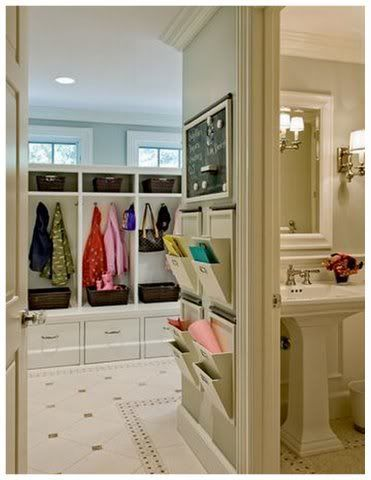Great organization in the mud room!  Gotta love pottery barn wall hanging system!