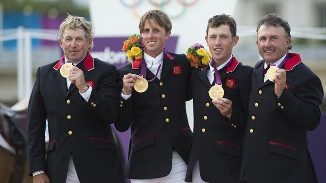 Great Britain's showjumping team of Nick Skelton, Ben Maher, Scott Brash and Pete Charles receive gold medals on August 6 2012 at the London Olympic Games