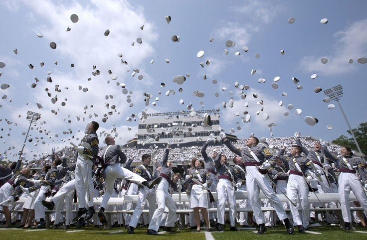 Graduates of The United States Military Academy throw up their hats at the end off the commencement ceremony May 26, 2012 in West Point, New York. US Vice President Joe Biden addressed the approximate 1,000 members of the Class of 2012 to receive Bachelor of Science degrees and be commissioned as second lieutenants in the US Army. (Photo by Lee Celano/Getty Images)  LEE CELANO - GETTY IMAGES