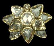 Imelda Marcos ; Diamond crab shaped brooch.