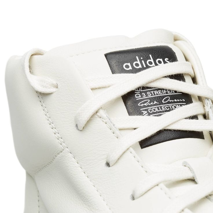 Mastodon Pro model II sneaker from the F/W2017-18 Rick Owens x Adidas collection in white These sneakers are from Rick Owens collection in collaboration with Adidas. The high top sneaker, here in white, is made of leather and features the iconic superstar toe cap, a rubber sole and also, Rick Owens and Adidas logos. - High top sneakers - Rubber sole - Rick Owens logo - Adidas logo - Composition: 100% Leather - Liner: 50% Leather 50% Cotton - Outsole: 100% Rubber - Made in China - Sizing:...