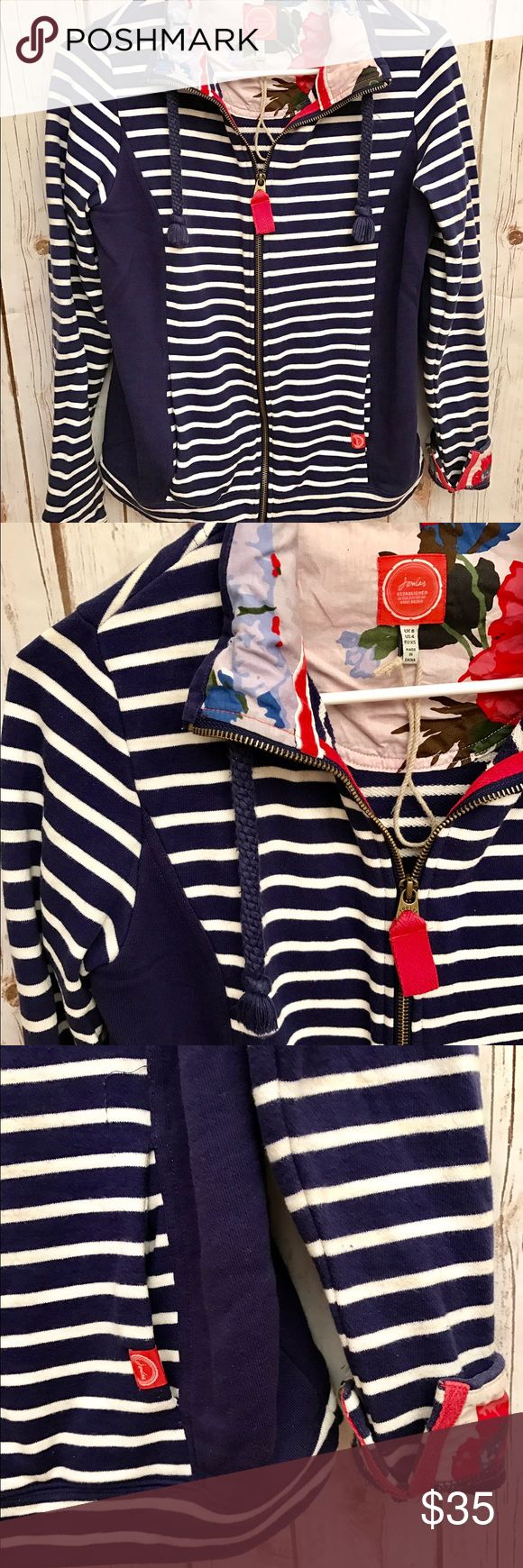 Joules Striped Jacket Adorable Navy and white striped zip up jacket. This jacket has an inner floral pattern and striped on the outside. Pockets on the side in the front and elbow pads on the back. European brand jacket in great preloved condition.  US size 4. Joules Jackets & Coats