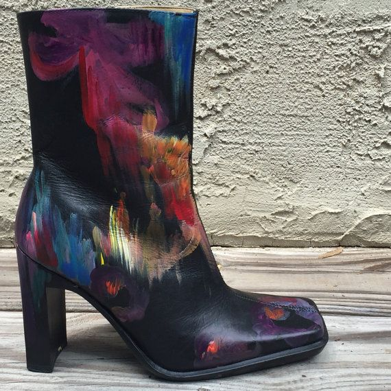 Stunning high fashion boots with a fun pop art style! The design is very colorful and painted in an abstract style. The colors vary from blue, red, purple and yellow to create an unique and attention grabbing look. The woman who wears these boots will definitely start her own fashion trend. The boots are black leather with high fashion block heels. Size 6.5.