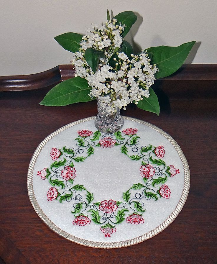 Flower Array embroidery design on a doily