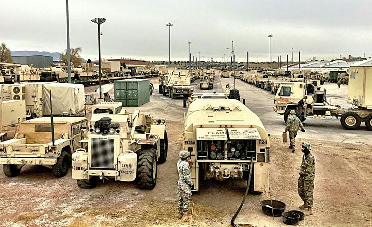 Soldiers of the 3rd ABCT, 4th ID load their equipment on railcars at Fort Carson, Colorado. The Brigade is moving to Poland for NATO training(US Army photo)