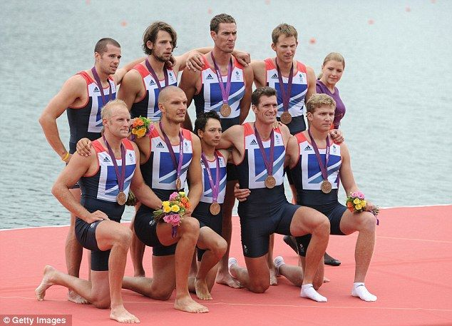 Medal men: The Great Britain team pose with their bronze medals for Men's Quad Sculling