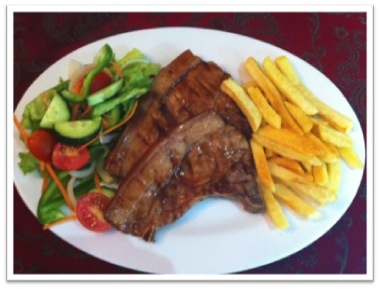 2 grilled pork chops served with golden fries and a fresh green salad on the side - available until 16 Feb 2013