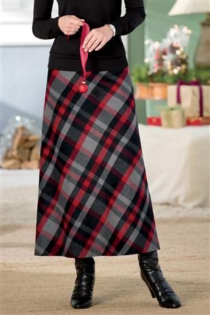 Don't love the pattern, and think the length is a hair long, but like the slight aline long skirt, boots, sweater over it.